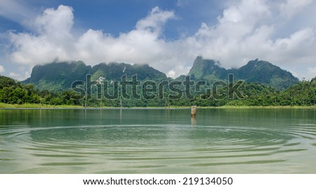 Nice scene of bay see smooth water and foggy on mountain