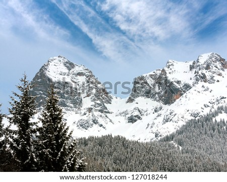 Nice scene with mountain rocks in winter time