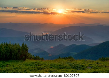 Nice scene with sunset in mountains