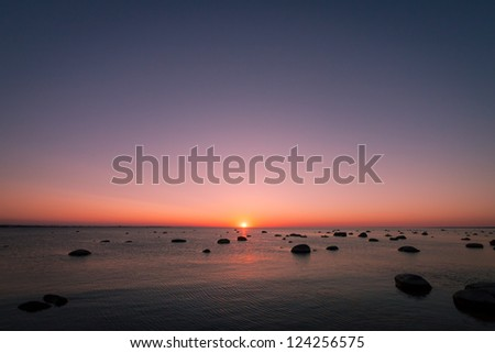 Nice scene with sunset over north summer sea