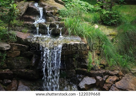 Nice small waterfall in summer forest