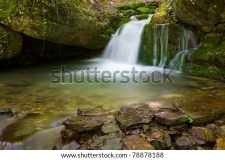 nice small waterfall on mountain stream