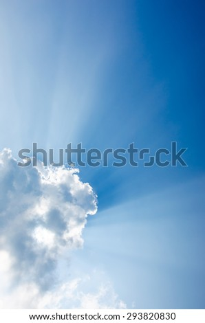 Nice sun beam shining through clouds sky