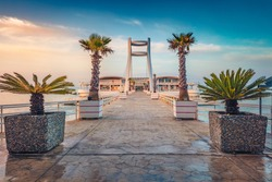 Nice sunrise in Durres, port city on the Adriatic Sea in western Albania, Europe. Picturesque Adriatic seascape. Calm spring scene of Albania. Traveling concept background.