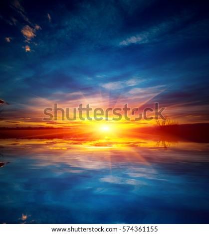 Nice sunset over water su?face #574361155