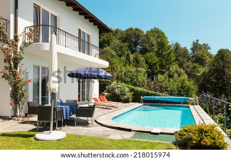 Nice terrace with swimming pool in a house