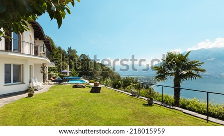 Nice terrace with swimming pool in a house, garden