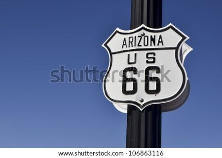 nice us highway 66 road sign in arizona against blue sky