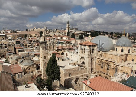 Nice view of the Christian Quarter of the Old City of Jerusalem. Holy Sepulcher against the blue sky and clouds.