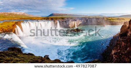Nice views of the bright sunlit powerful Godafoss cascade. Popular tourist attraction. Unusual and picturesque scene. Location Bardardalur valley, Skjalfandafljot river, Iceland, Europe. Beauty world. #497827087