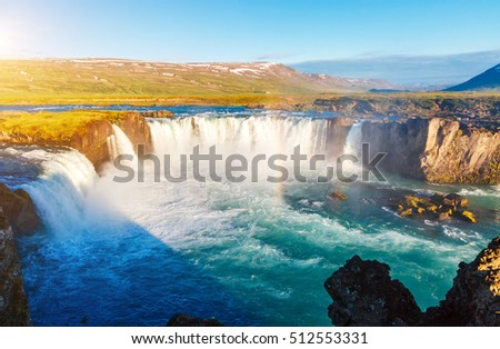 Nice views of the bright sunlit powerful Godafoss cascade. Popular tourist attraction. Unusual and picturesque scene. Location Bardardalur valley, Skjalfandafljot river, Iceland, Europe. Beauty world. #512553331