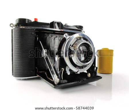 Nice vintage camera with a yellow film canister on white