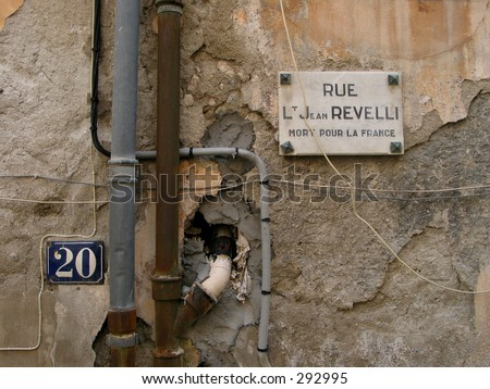 "Nice wall found in a little french mountain village near the Italian border. The old street sign tells all about where the heart of the poplulation belongs. ""Death over France""-  No unsharpen mask."