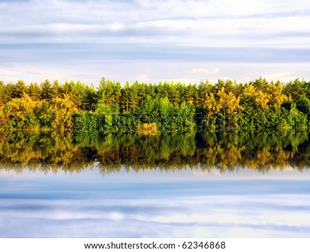 Nice water reflection with autumn forest