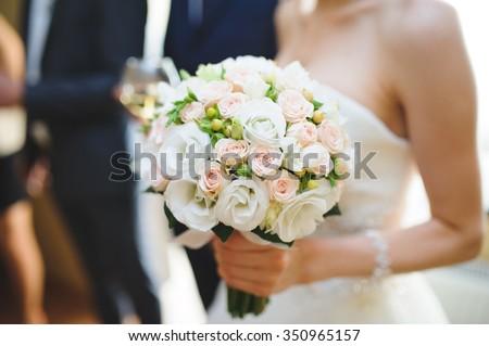 nice wedding bouquet in bride\'s hand
