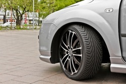 Nice wheel and rims of a sporty car in gray or silver. Leherheide Bremerhaven, Germany.