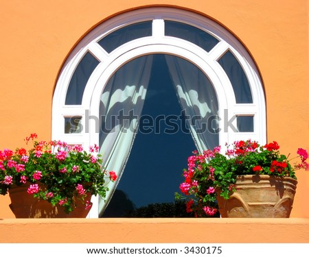 Nice window decorated with flowers