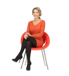 nice woman in dress sitting in chair