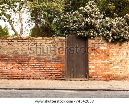 Nice wooden gate in a red brick wall