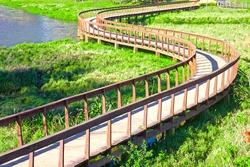 Nice wooden snake alike bridge in the park of Toronto (Parque de Toronto) in Sao Paulo, Brazil