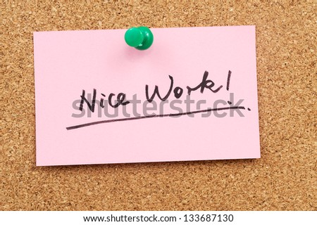 Nice work words written on paper and pinned on cork board