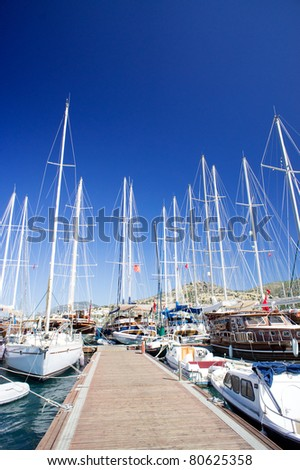 Nice yachts on an anchor in harbor. Bodrum. Turkey.