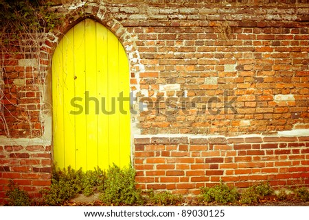 Nice yellow gate in a red brick wall