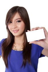 Nice young Asian woman with beautiful smile holding blank business card ready to use, isolated on white background
