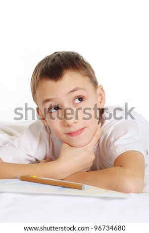 nice young boy on white floor with a pen