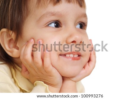 nice young child lie on the floor at the white background