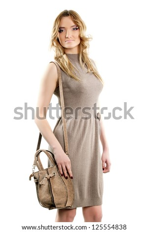 Nice young woman in a dress. Isolated on white