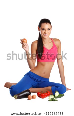 nice young woman posing with healthy foods