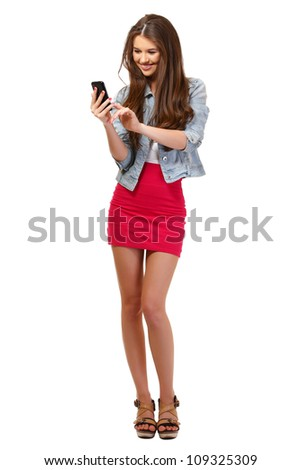 nice young woman posing with phone in studio