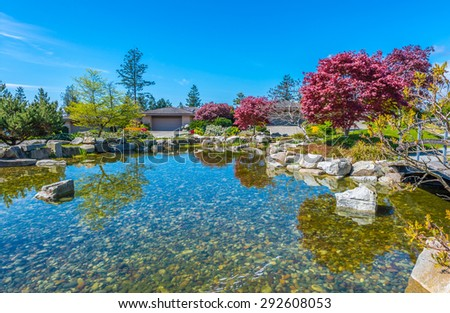 Nicely decorated and designed pond in the great neighborhood of Vancouver, Canada. Landscape design.