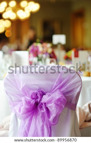 Nicely decorated chair at an event party or wedding
