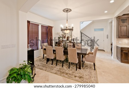 Nicely decorated dining, lunch room. Dining table and a few chairs around. Vertical. Interior design.
