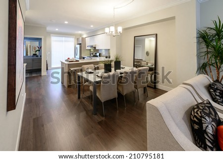Nicely decorated dining table and the kitchen at the back. Interior design. #210795181