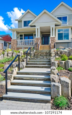 Nicely decorated house entrance. Stone steps leading to the house. Landscape design
