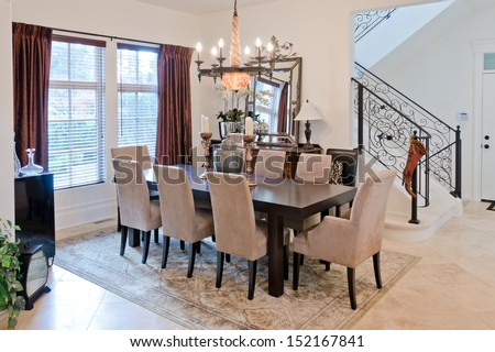 Nicely decorated luxury living ( lunch ), dining room. Dining table and some chairs. Interior design.