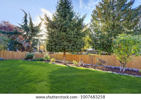 Nicely manicured backyard boasts Beautiful landscaping with green lawn and flowerbeds. Northwest, USA
