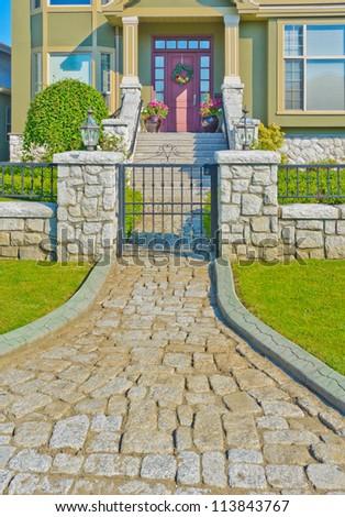 Nicely paved doorway. House entrance. Landscape design.