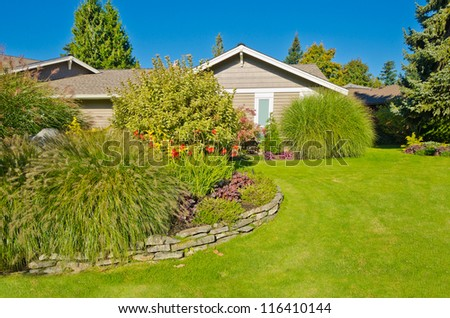Nicely trimmed and designed front yard lawn in the suburbs of Vancouver, Canada. Landscape design.