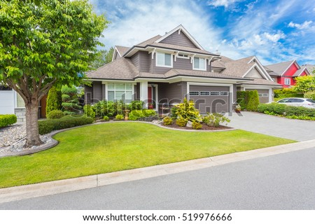 Nicely trimmed and manicured garden in front of a luxury house