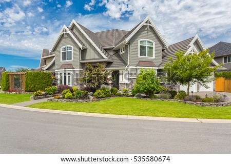Nicely trimmed and manicured garden in front of a luxury house. #535580674