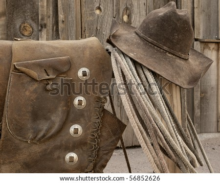 Nicely worn and distressed leather Western cowboy wear.