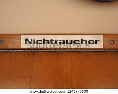 Nichtraucher (meaning Non smoking) sign on vintage German tram #1246973500