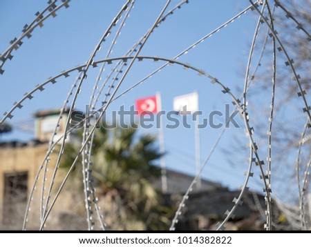 Nicosia Turkish occupation with flag and Concertina wire or Dannert Wire warzone Zdjęcia stock ©