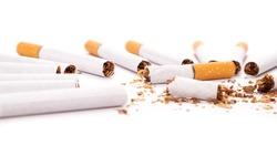 nicotine addiction,harm of smoking broken cigarette on white background.