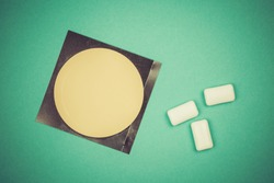 Nicotine patch and chewin gum used for smoking cessation isolated on green background