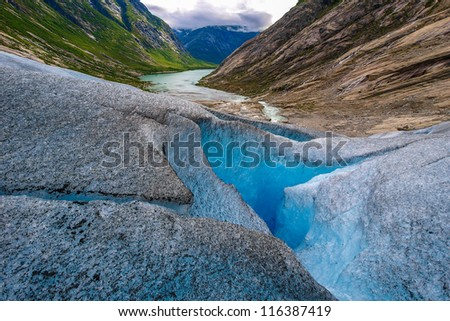Nigardsbreen is a glacier arm of the large Jostedalsbreen glacier. Nigardsbreen lies about 30 kilometres north of the village of Gaupne in the Jostedalen valley, Luster, Sogn og Fjordane county